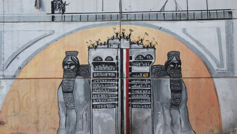A mural in Tahrir Square in Baghdad depicting two Assyrian lamassus protecting the 'Turkish Restaurant' building that had been taken over by protests in 2019. Ammar al Jazaeri (Photographer)
